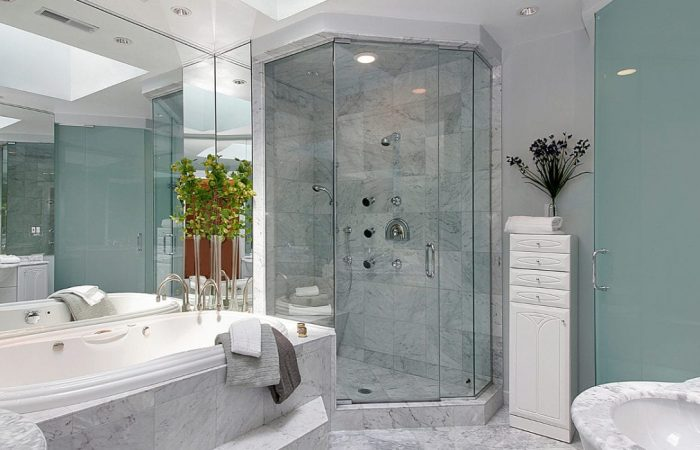 Upscale master bath with marble sink and tub